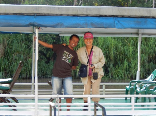 Our guide, Azie, on klotok, Harapan Mina -Borneo