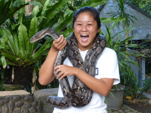Lauren holding snake at Monkey Forest, Bali